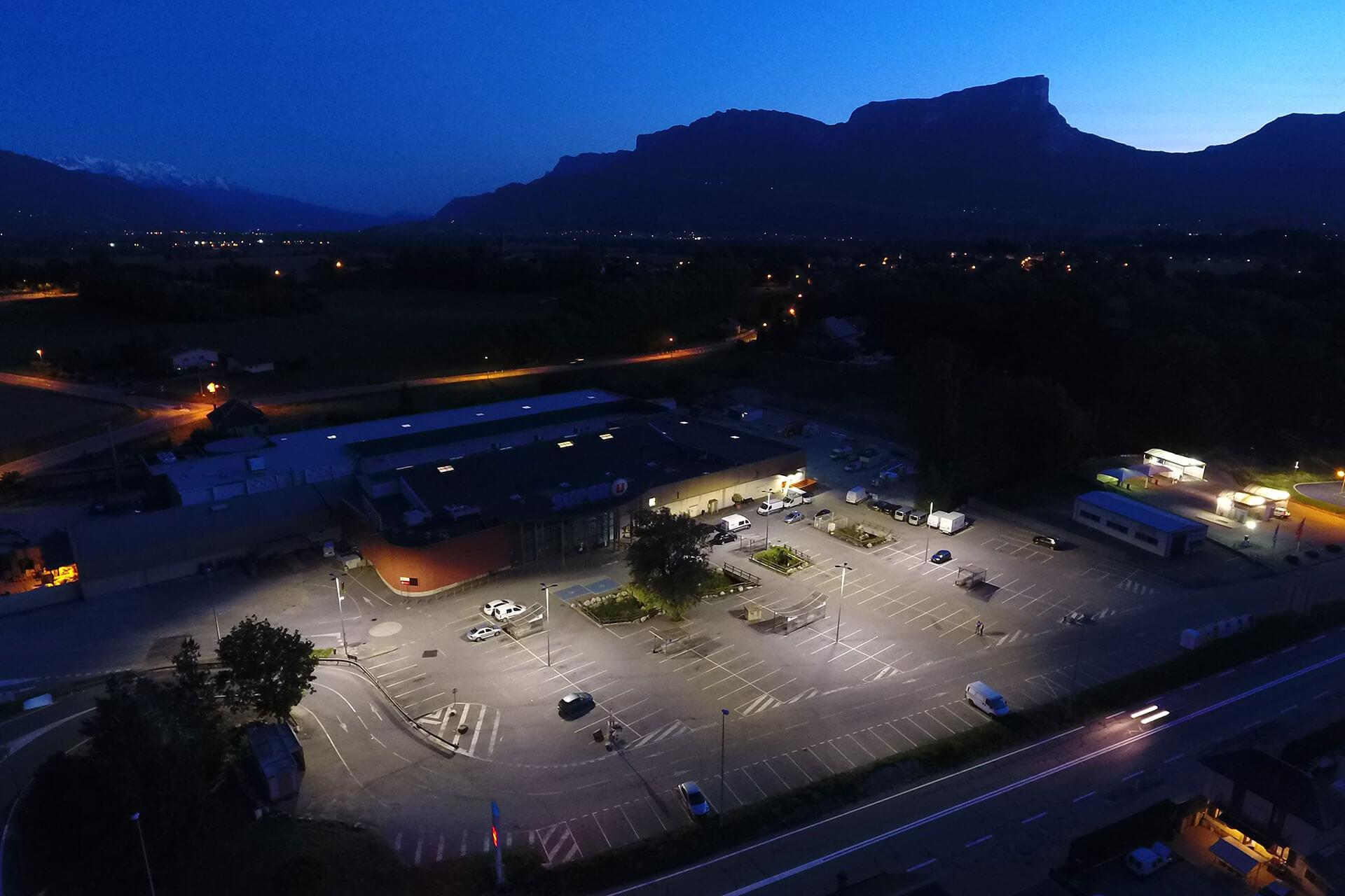 Schréder LED luminaires deliver a sustainable lighting solution, reducing any light spill, for this supermarket car park in Montmelian